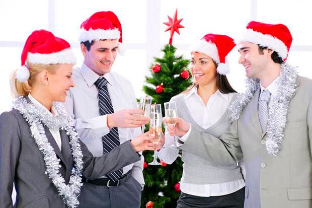 Cheerful business team toast success.